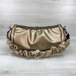 Золотая сумка багет со складками